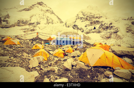 Tents in Everest Base Camp in cloudy day, Nepal, vintage instagram retro style. - Stock Photo