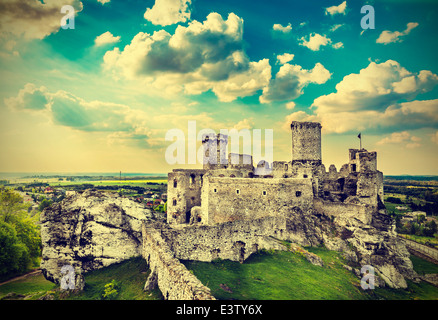 Ruins of a castle, Ogrodzieniec fortifications, Poland, vintage retro filter. - Stock Photo
