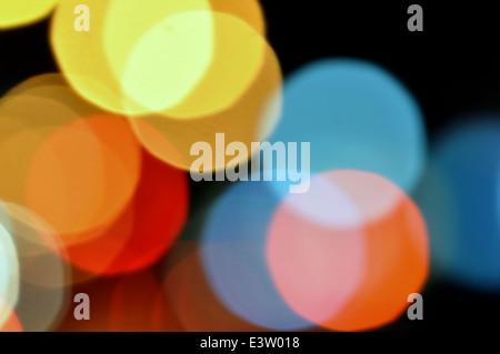 Abstract blurry lights at night colorful circles background.