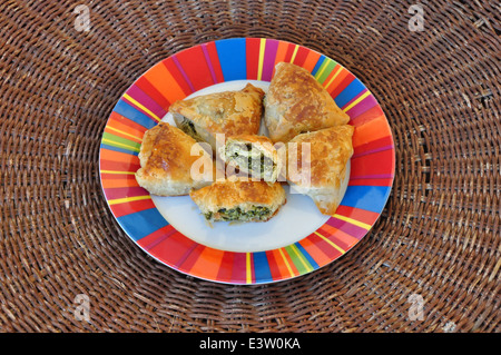 Spanakopita spinach pie with feta cheese and crispy filo dough. Greek food. - Stock Photo