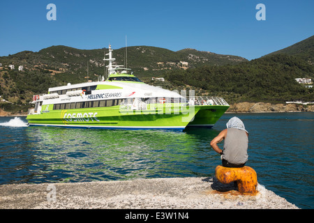 The Hellenic Seaways Flying Cat ferry, in green Cosmote livery, arrives in Skopelos harbour. - Stock Photo