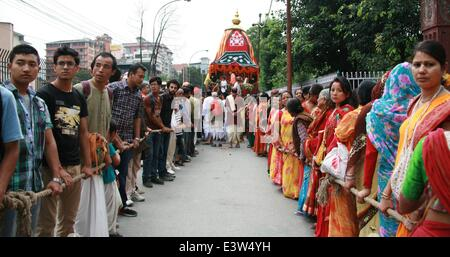 Kathmandu, Nepal. 29th June, 2014. Nepalese devotees participate in the pulling of the chariot of Lord Jagannath - Stock Photo