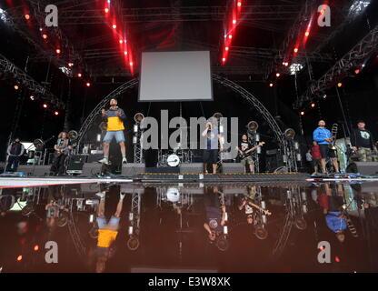 ITAR-TASS: ST. PETERSBURG, RUSSIA. JUNE 29, 2014. Belarusian rock band Lyapis Trubetskoy performs onstage during - Stock Photo