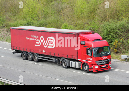 A Norbert Dentressangle truck traveling along the M20 motorway in Kent, England - Stock Photo