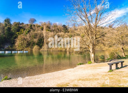 Fives boating on swanbourne Lake in Arundel, West Sussex - Stock Photo