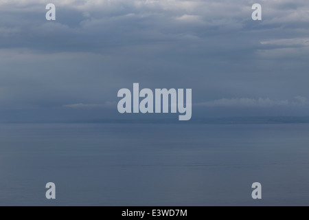 View of Welsh coastline from above Porlock in Somerset. Storm clouds rolling in over the Bristol Channel. - Stock Photo