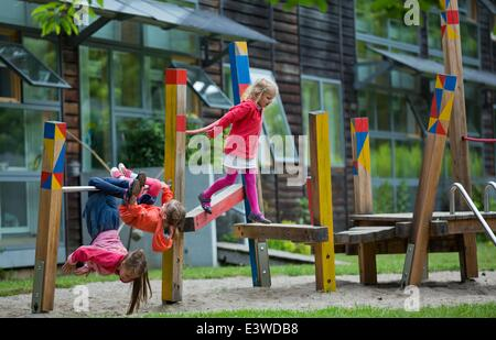 Wismar, Germany. 19th June, 2014. Children play in the garden of the integrated nursery 'Plappersnut' in Wismar, - Stock Photo