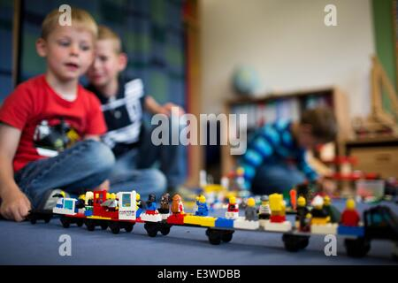 Wismar, Germany. 19th June, 2014. Julien plays with his friends in one of the group rooms of the integrated nursery - Stock Photo