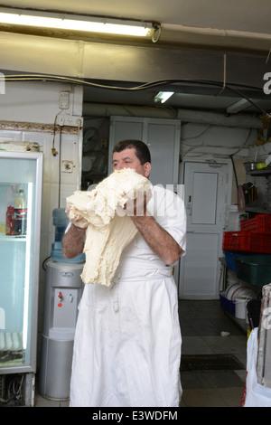 Pita Bakery. Baker is kneading the dough - Stock Photo