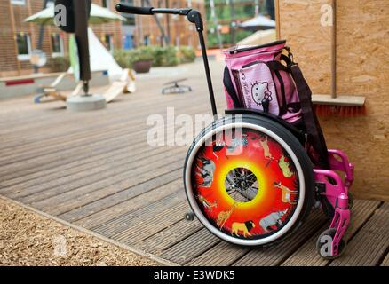 Wismar, Germany. 19th June, 2014. A childrens' wheelchair stands near the exit door to the garden of the integrated - Stock Photo