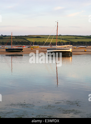 Cornish Crabber sailing boats aground in the Camel estuary in north Cornwall, seen from Rock on the north-east shore - Stock Photo