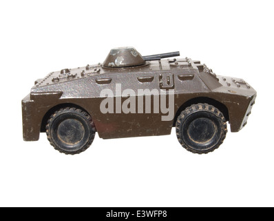 Children's toy: a very old toy tank metal green isolated on white background. - Stock Photo