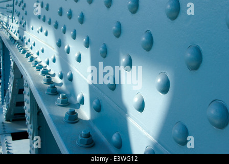 blue painted bridge steel construction close up with bolts and nuts - Stock Photo