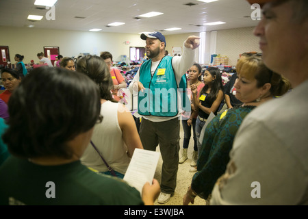 volunteers at Catholic Charity shelter in McAllen, Texas. Surge of immigrants from Central America crossed  Texas - Stock Photo