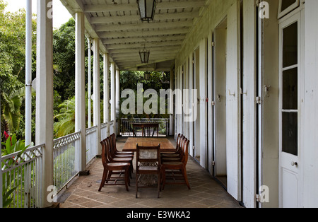Table And Chairs On Veranda Of La Maison Creole A French Colonial House  Also Known As