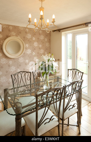Glass topped table in traditional style dining room, Cheshire, UK - Stock Photo