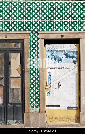 Traditional Azulejos tiles surround old doorways in Ilhavo, Aveiro, Portugal - Stock Photo