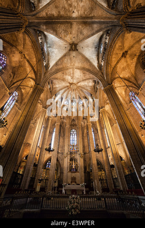 High altar, apse and vaulted ceiling of the Barcelona Cathedral in Catalonia, Spain, Gothic style. - Stock Photo