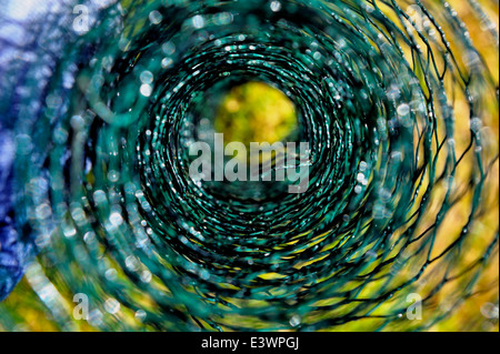 A roll of green chicken mesh wire close up abstract - Stock Photo