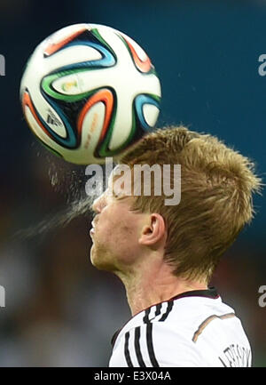 Porto Alegre, Brazil. 30th June, 2014. Germany's Per Mertesacker heads the ball during a Round of 16 match between - Stock Photo