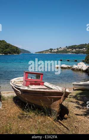 Old worn-out Greek fishing boat, in the bay of Blo, Panormas, on the Greek island of Skopelos. - Stock Photo