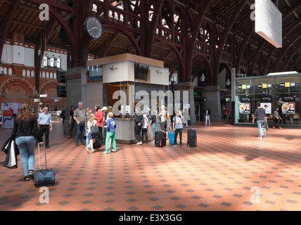 Copenhagen central station. The traditional meeting point under the clock in the station building. Departure and - Stock Photo