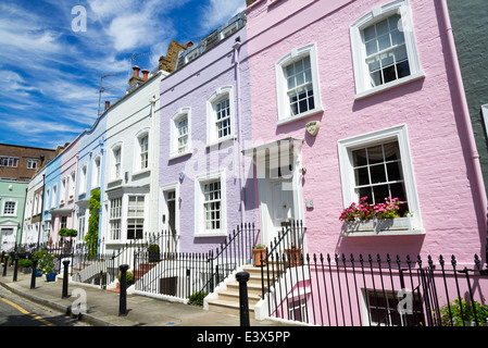 Colourful row of terraced town houses on Bywater Street, Chelsea, London, England, UK - Stock Photo