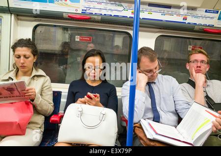 People on the London Underground, UK - Stock Photo
