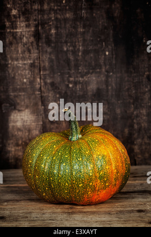 Pumpkin on old wooden table - Stock Photo