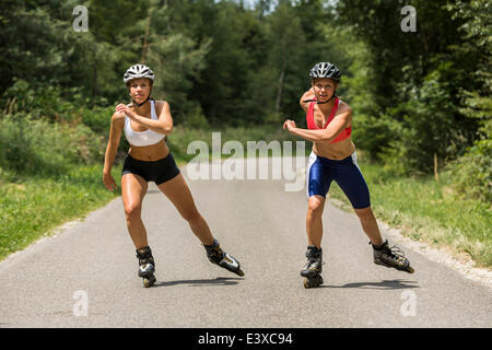 Young women, 19 years, inline skating, country road, Schurwald, Baden-Württemberg, Germany - Stock Photo