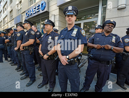 A group of policemen await instruction before the Gay Pride Parade in New York City. - Stock Photo