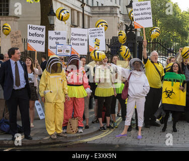 Whitehall, London, UK. 1st July 2014. Protesters in yellow and black swarm opposite the entrance to Downing Street - Stock Photo