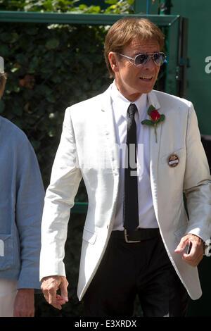 Wimbledon, London, UK. 1st July 2014. Sir Cliff Richard on day 8 of the 2014 Wimbledon lawn tennis championships - Stock Photo
