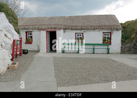 Street lined with crofters ( thatched cottages ), Doagh Famine Village, Lagacurry, Inishowen Peninsula, County Donegal, - Stock Photo