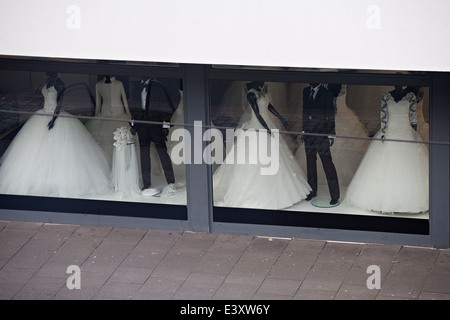 Exterior of bridal boutique with wedding dresses displayed in shop ...
