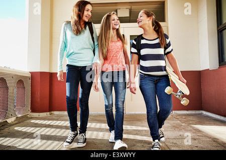 Teenage girls walking on school campus