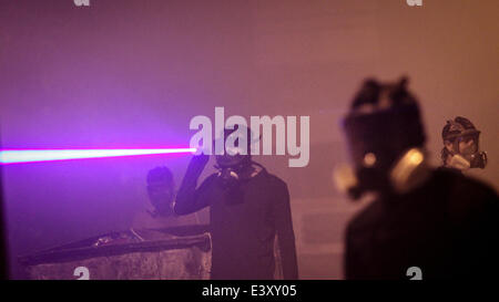 June 30, 2014 - Abu Saiba, Bahrain - Residents use lasers flashlights as they clash with police in the village of - Stock Photo