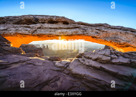 Sun rising over mesa arch, Canyonlands, Utah, United States - Stock Photo