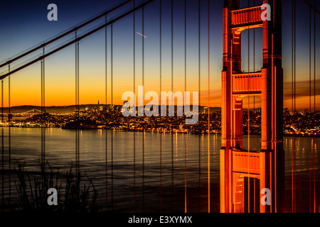 Golden Gate Bridge and San Francisco skyline lit up at night, San Francisco, California, United States - Stock Photo