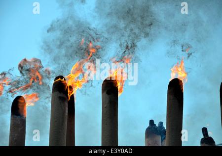 Huge joss sticks burning during Chinese New Year festival - Stock Photo