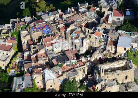 PERCHED MEDIEVAL VILLAGE, HEAVILY DAMAGED BY AN EARTHQUAKE, RESTORED BY ARTISTS (aerial view). Bussana Vecchia, - Stock Photo