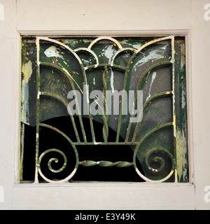Abstract cosmic tree of life with spiral roots and seven branches. Vintage iron motif on old window. - Stock Photo