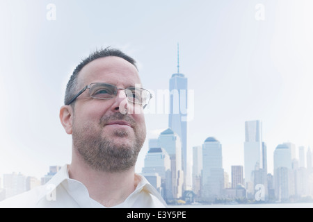 Portrait of mature man and cityscape, Jersey City, New Jersey State, USA - Stock Photo