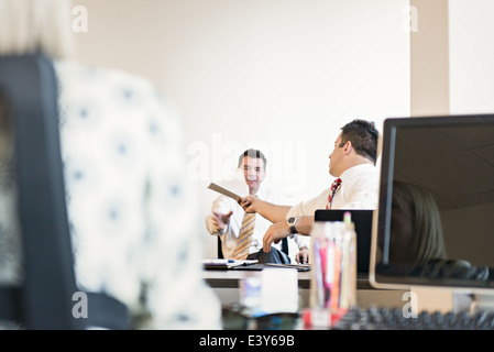 Three business lawyers busy in office - Stock Photo