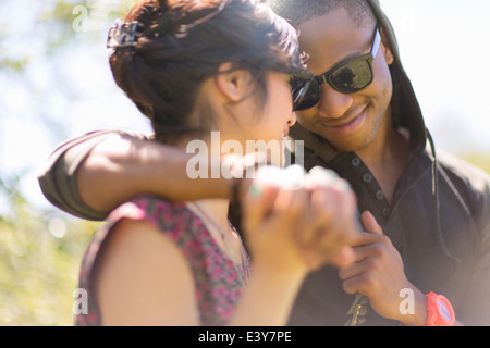 Close up of romantic young couple holding hands