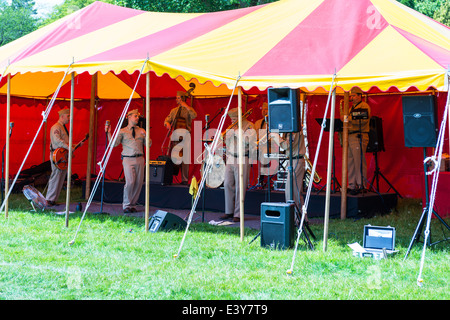 East Devon, England. A Fete and garden party with a group playing American 1940s music dressed in American WW2 army - Stock Photo