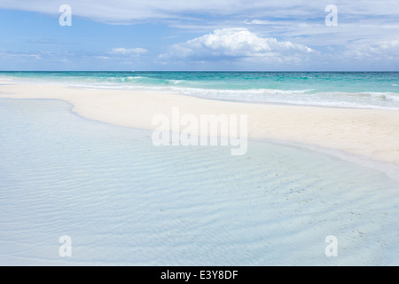 Peaceful emptiness on the white sand beach of Tulum, Mexico. - Stock Photo