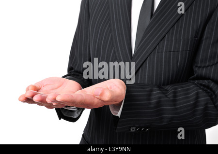 man wearing a suit with his hands open, as begging or showing or holding something - Stock Photo