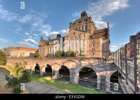 The Opera House and State Theatre of Nuremberg, with the Opernhaus U-bahn stop and moat beneath. - Stock Photo
