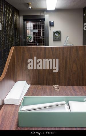 An open safe deposit box inside a bank vault, USA. - Stock Photo